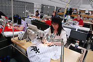 4/3/09 10:51:37 AM -- Easton, PA, U.S.A. -- Barbara Graver, a seamstress at Majestic Athletic sews lettering on the back of a Chicago White Sox jersey April 3, 2009 in Easton, Pennsylvania. White Sox jerseys and gear have experienced a boost in sales with Obama, a White Sox fan, in the White House. -- .Photo by William Thomas Cain,  cainimages.com