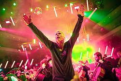 "© Licensed to London News Pictures . 05/02/2016 . Manchester , UK . BEZ ( Mark Berry ) . "" Hacienda Classical "" debut at the Bridgewater Hall . The 70 piece Manchester Camerata and performers including New Order's Peter Hook , Shaun Ryder , Rowetta Idah , Bez and Hacienda DJs Graeme Park and Mike Pickering mixing live compositions . Photo credit : Joel Goodman/LNP"
