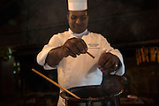 Sous Chef Sujith Arlyaratne breaks a cinnamon and puts it in a pineapple, mango, honey and cinnamon curry at the Nugagama Restaurant at the Cinnamon Grand Hotel in central Colombo. The restaurant is renowned for its traditional 'village' Sri Lankan food with every dish using cinnamon in some degree.