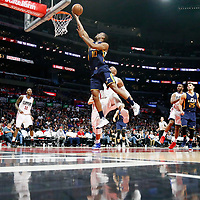 25 March 2016: Utah Jazz guard Alec Burks (10) goes for the layup past LA Clippers center Marreese Speights (5) during the Los Angeles Clippers 108-95 victory over the Utah Jazz, at the Staples Center, Los Angeles, California, USA.