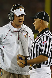 September 11, 2010; Los Angeles, CA, USA;  Southern California Trojans head coach Lane Kiffin talks to an official during the second quarter against the Virginia Cavaliers at the Los Angeles Memorial Coliseum.