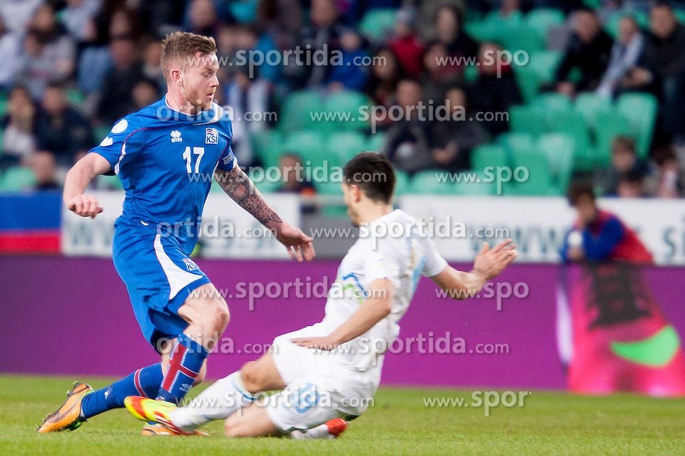 Aron Einar Gunnarsson #17 of Iceland and Aleksandar Radosavljevic #18 of Slovenia during football match between National teams of Slovenia and Iceland in Group E of FIFA World Cup 2014 Qualification on March 22, 2013 in SRC Stozice, Ljubljana, Slovenia. (Photo By Urban Urbanc / Sportida).