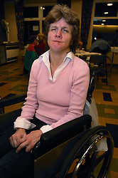 Wheelchair user at a social event organised by disability friendship club,