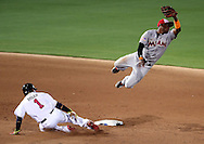 Jul 3, 2016; Ft. Bragg, NC, USA; Miami Marlins shortstop Adeiny Hechavarria (3) misses a throw as Atlanta Braves shortstop Erick Aybar (1) slides into second base during the fifth inning at Fort Bragg. Mandatory Credit: Peter Casey-USA TODAY Sports