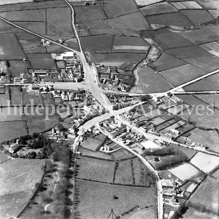 A40 Ballyjamesduff.   (22/01/54) (Part of the Independent Newspapers Ireland/NLI collection.)<br /> <br /> <br /> These aerial views of Ireland from the Morgan Collection were taken during the mid-1950's, comprising medium and low altitude black-and-white birds-eye views of places and events, many of which were commissioned by clients. From 1951 to 1958 a different aerial picture was published each Friday in the Irish Independent in a series called, 'Views from the Air'.<br /> The photographer was Alexander 'Monkey' Campbell Morgan (1919-1958). Born in London and part of the Royal Artillery Air Corps, on leaving the army he started Aerophotos in Ireland. He was killed when, on business, his plane crashed flying from Shannon.
