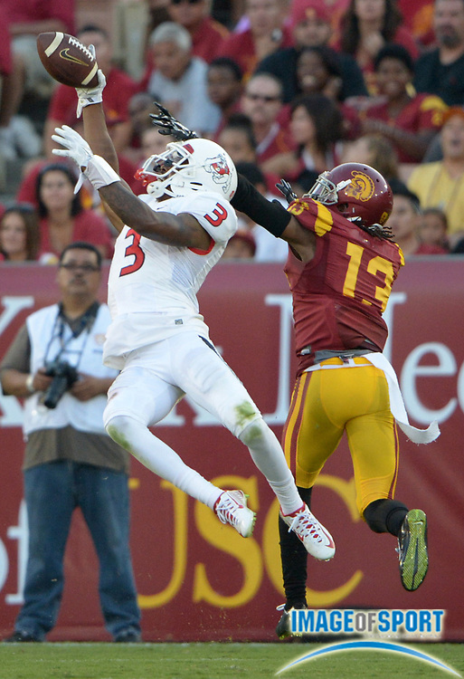Aug 30, 2014; Los Angeles, CA, USA; Fresno State Bulldogs receiver Josh Harper (3) is defended by Southern California Trojans cornerback Kevon Seymour (13) at Los Angeles Memorial Coliseum. USC defeated Fresno State 52-13.