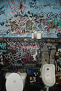 The men's room of the Hole in the Wall club in Austin Texas during South by Southwest music festival 2008.