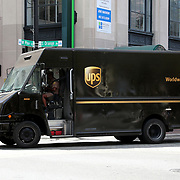 A UPS delivery truck drives down Orange Avenue as it delivers packages in downtown Orlando on Monday, March 30, 2020 in Orlando, Florida. (Alex Menendez via AP)