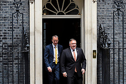 © Licensed to London News Pictures. 21/07/2020. LONDON, UK.  Mike Pompeo, US Secretary of State, exits Number 10 Downing Street, accompanied by Dominic Raab, Foreign Secretary, after talks with Boris Johnson, Prime Minister.  The agenda was expected to include the COVID-19 economic recovery plans, issues related to the People's Republic of China (P.R.C.) and Hong Kong, and the U.S.-U.K. Free Trade Agreement negotiations..  Photo credit: Stephen Chung/LNP