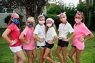 Merrick, New York, U.S. August 15, 2020. Tweens, L-R, KATIE, REESE, MADDY, ANNIE FITZPATRICK, ISABELLE, and MARIA, all wearing face masks, pose after hours of selling shells they painted, to raise funds to donate to American Cancer Society Making Strides Against Breast Cancer. When Annie's 24-year-old sister Lizzie Fitzpatrick was diagnosed with Triple Negative Breast Cancer in late June, Annie, Maddy, and Isabelle formed Lizzie's Army. Over $3,000 has been raised so far through shell sales and GoFundMe.