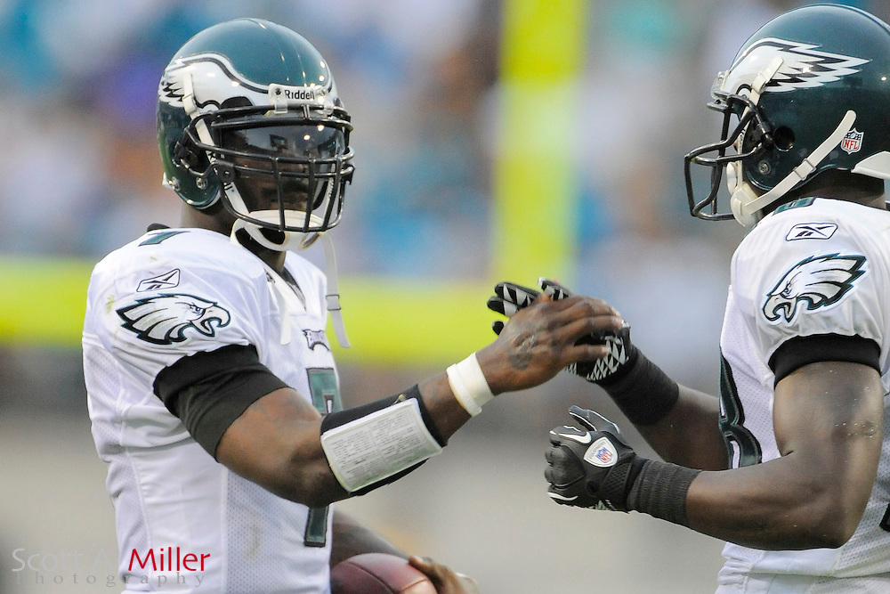Sept. 26, 2010; Jacksonville, FL, USA; Philadelphia Eagles quarterback Michael Vick (7) celebrates play with Philadelphia Eagles wide receiver Jeremy Maclin (18) during the Eagles 28-3 win over the Jacksonville Jaguars at EverBank Field. ©2010 Scott A. Miller
