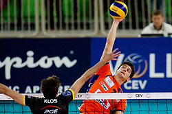 Matevz Kamnik of ACH during volleyball match between ACH Volley LJUBLJANA and  PGE Skra Belchatow (POL) of 2012 CEV Volleyball Champions League, Men, League Round in Pool F, 4th Leg, on December 20, 2011, in Arena Stozice, Ljubljana, Slovenia. Belchatow defeated ACH 3-0. (Photo By Vid Ponikvar / Sportida.com)