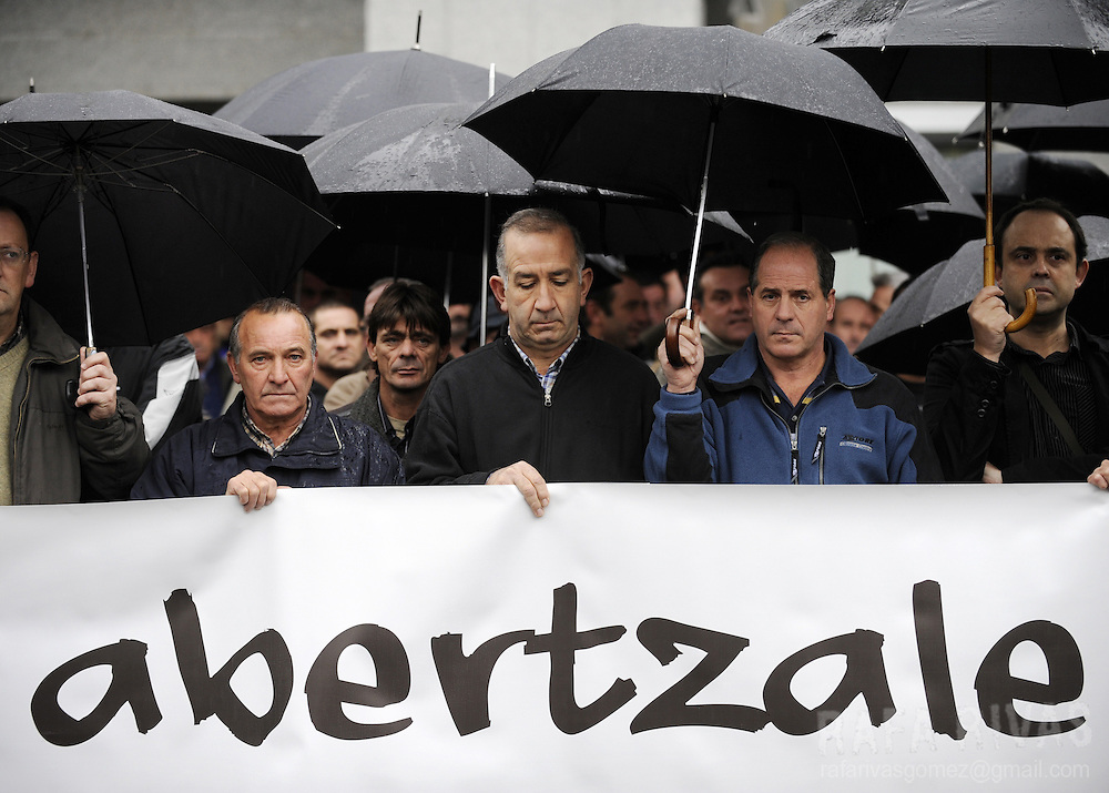 "Workers of Uria y Altuna company protest during a demonstration against Ignacio Uria's murder in the northern Spanish Basque village of Azpeitia  on December 4, 2008. Word on banner reads ""patriot"" in Basque. Suspected ETA separatists shot dead on December 3, 2008 businessman Ignacio Uria Mendizabal, 71, head of the company Altuna y Uria, involved in the construction of a high-speed railway in the region -- a project opposed by ETA."