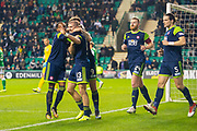 Alex Gogic (#13) of Hamilton Academical FC celebrates with team mates after scoring the opening goal during the Ladbrokes Scottish Premiership match between Hibernian FC and Hamilton Academical FC at Easter Road Stadium, Edinburgh, Scotland on 22 January 2020.