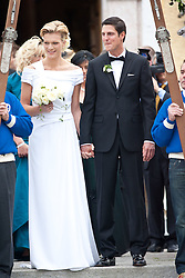 16.04.2011, Going am Wilden Kaiser, Tirol, AUT, kirchliche Trauung von Maria Riesch und Markus Höfl in der Pfarrkirche zum Hl. Kreuz, im Bild die Skirennfahrerin Maria Höfl-Riesch und ihr Ehemann Marcus Höfl posen für die Fotografen // the german skieracer Maria Riesch-Hoefl and her husband Marcus Hoefl during church wedding at Church of the Holy Cross in Going, Austria on 16/4/2011. EXPA Pictures © 2011, PhotoCredit: EXPA/ J. Groder / SPORTIDA PHOTO AGENCY