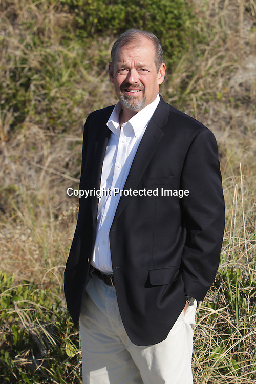 The photo shoot with Loran Johnson or RE/MAX Essential Thursday November 20, 2014 at Wrightsville Beach, N.C. (Jason A. Frizzelle)