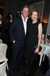 ROBERT HERSOV and JULIA PEYTON-JONES at a dinner for the Serpentine Gallery's Council held at Morton's, Berkeley Square, London on 5th December 2011.
