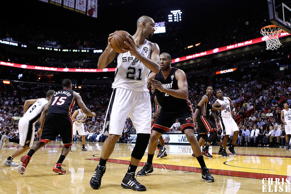 14 March 2011: Miami Heat center Jamaal Magloire (21) defends on San Antonio Spurs center Tim Duncan (21) during the Miami Heat 110-80 victory over the San Antonio Spurs at the AmericanAirlines Arena, Miami, Florida, USA.