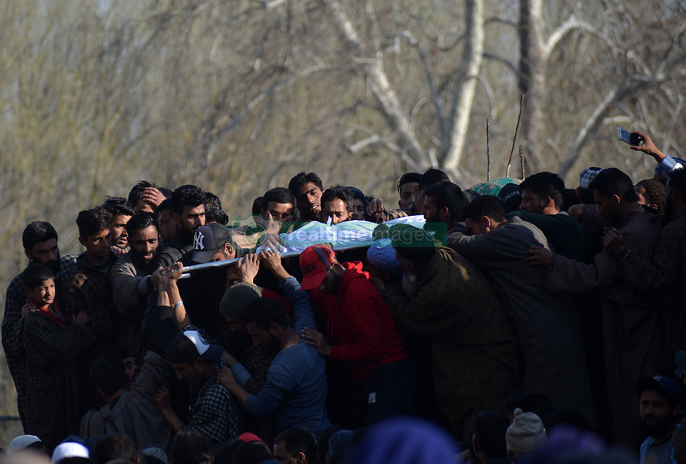March 22, 2019 - Srinagar, Kashmir, India - Kashmir People carry the charred body of a 12-year-old boy Atif Shafi Mir during his funeral procession in Hajin area of  Bandipora some 35 kilometers from Srinagar, Kashmir on March 22, 2019. A 12-year-old boy was among six militants killed in three gun battles between militants and Indian security forces across the valley, Indian police reported. (Credit Image: © Faisal Khan/NurPhoto via ZUMA Press)