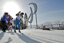 NITTA Yoshihiro, BATMUNKH Ganbold competing in the Nordic Skiing XC Long Distance at the 2014 Sochi Winter Paralympic Games, Russia