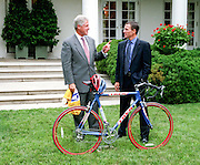 U.S President Bill Clinton speaks with Lance Armstrong, 1999 winner of the Tour de France, in the Rose Garden of the White House August 10, 1999. Armstrong presented the president a replica of the bike Armstrong used in the race and a race team jersey.