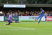 Tom Elliott of AFC Wimbledon scores, during the Sky Bet League 2 match between AFC Wimbledon and Cambridge United at the Cherry Red Records Stadium, Kingston, England on 18 August 2015. Photo by Stuart Butcher.