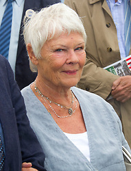 SANDRINGHAM- UK -31-JULY-2013: Dame Judy Dench as a house guest, accompanies Britain's Prince Charles, The Prince of Wales and Camilla, The Duchess of Cornwall attend the annual Sandringham Flower SHow in the grounds of Sandringham House in Norfolk. The rain did not put off the crowds who lined their route around the show, at the end of which Prince Charles met Zephr, The Bald Eagle mascot of the Army Air Corps which The Prince is the Colonel-In Chief of.<br /> Photo Ian Jones