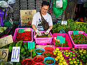 29 JUNE 2017 - SAMRONG NUEA, SAMUT PRAKAN, THAILAND: A vendor in the market in Samrong Nuea district, Samut Prakan province. The district is currently the last stop on the Bangkok BTS Skytrain mass transit light rail system and although only minutes from central Bangkok retains a small town feeling.          PHOTO BY JACK KURTZ
