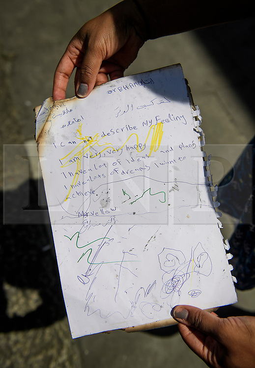 © Licensed to London News Pictures. 14/06/2017. London, UK. The burnt remains of a note written by a child expressing their happiness and dreams, found neat the scene of a huge fire at Grenfell tower block in White City, London. The blaze engulfed the 27-storey building with 200 firefighters attending the scene. There were reports of people trapped in the building. Photo credit: Ben Cawthra/LNP