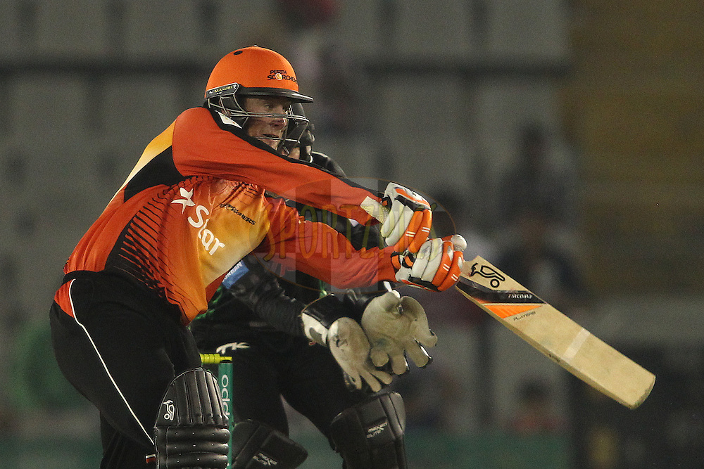 Sam Whiteman of the Perth Scorchers drives a delivery through the covers during match 4 of the Oppo Champions League Twenty20 between the Dolphins and the Perth Scorchers held at the Punjab Cricket Association Stadium, Mohali, India on the 20th September 2014<br /> <br /> Photo by:  Shaun Roy / Sportzpics/ CLT20<br /> <br /> <br /> Image use is subject to the terms and conditions as laid out by the BCCI/ CLT20.  The terms and conditions can be downloaded here:<br /> <br /> http://sportzpics.photoshelter.com/gallery/CLT20-Image-Terms-and-Conditions-2014/G0000IfNJn535VPU/C0000QhhKadWcjYs