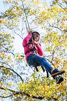 Girl on rope swing.