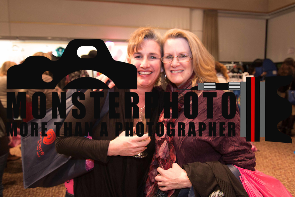 LEFT TO RIGHT: Andrea Rossi and Trish Sherwin pose for a photo during the 3rd Annual Guilty Girls Warehouse Sale Friday, Feb. 06, 2015 at University of Delaware's Arsht Hall in Wilmington, DE.