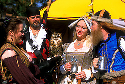 Stock photo of a group in costume drinking and socializing at the Texas Renaissance Festival in Plantersville Texas