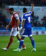 Britt Assombalonga appreciates an attempted pass during the Sky Bet Championship match between Rotherham United and Nottingham Forest at the New York Stadium, Rotherham, England on 13 December 2014.