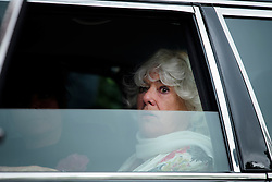 © Licensed to London News Pictures. 18/04/2016. Shirley, UK.  Ronnie Corbett's wife, Anne has a tear in her eye as she leaves The funeral of comedian, actor, writer Ronnie Corbett, held at St John the Evangelist Church in Shirley near Croydon. Corbett, who was most famous for his comedy sketch show  The Two Ronnies, performed with the late Ronnie Barker, died at the age of 85. Photo credit: Ben Cawthra/LNP