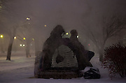 Homeless people huddle around a steam vent during a snow storm in Washington, DC on January 22, 2016. The east coast is preparing for a blizzard that is expected to dump 20 to 30 inches overnight.  Photo by Molly Riley/UPI