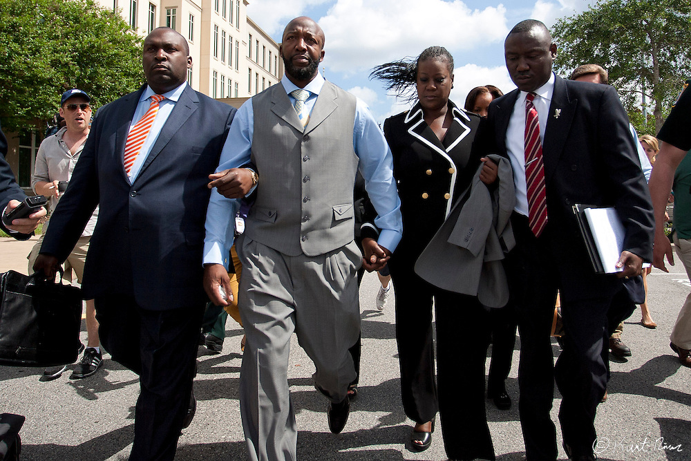 April 20, 2012 - Sanford, Florida, U.S. - DARYL PARKS (left), TRACY MARTIN, SYBRINA FULTON, and  BENJAMIN CRUMP (right)  after George Zimmerman's bond was set to $150,000 for the murder of Trayvon Martin at the Sanford Criminal Justice Center in Sanford, Florida.