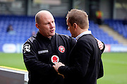 Walsall manager Jon Whitney talking to AFC Wimbledon manager Neal Ardley during the EFL Sky Bet League 1 match between AFC Wimbledon and Walsall at the Cherry Red Records Stadium, Kingston, England on 25 February 2017. Photo by Matthew Redman.