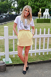 OLIVIA COX at the launch of Chelsea Thoroughbreds held at St.Luke's Church, Sydney Street, London on 2nd July 2014.