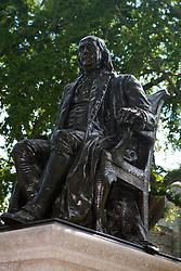 Statue of Benjamin Franklin sitting on a chair, University of Pennsylvania, Philadelphia, Pennsylvania, United States of America