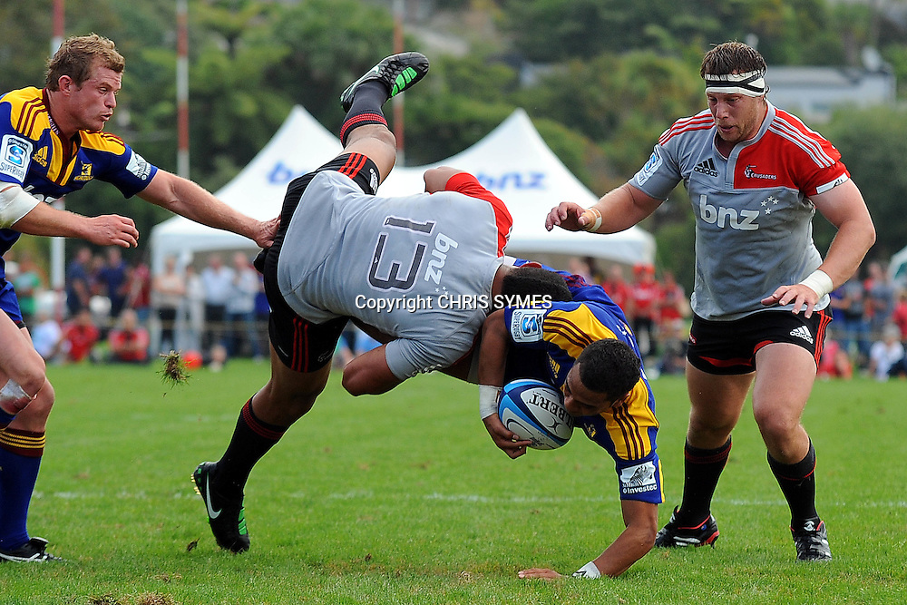 Crusaders Robbie Fruean tackles Highlanders player Telusa Veainu during their Super Rugby Pre-season game Crusaders v Highlanders. Rugby Park, Greymouth, New Zealand. Friday 3 February 2012. Photo: Chris Symes/www.photosport.co.nz