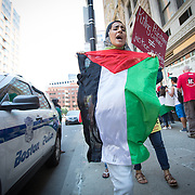 Two groups, one of Palestinian supporters, and and another of supporters of Israel protest the recent events in Israel at In front of the Israeli Consulate at 20 Park Plaza on July 11, 2014 in Boston, Massachusetts. (Photo by Elan Kawesch/The Times of Israel)