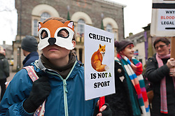 © Licensed to London News Pictures. 01/01/2019. Carmarthen, Carmarthenshire, Wales, UK. Anti-Bloodsport activists gather in the Welsh town of Carmarthen to voice their anger at the continued illegal hunting with dogs - hunting with dogs was made illegal in 2004 by The Hunting Act 2004 (c37). The Anti-Hunt protest takes place on the day that the Carmarthenshire Hunt have chosen to parade through the town to collect money and support for their blood-sports. Photo credit: Graham M. Lawrence/LNP