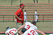 NCAA FCS: VMI football spring scrimmage - New VMI defensive coordinator Greg Harris warms up his squad prior to Saturday's scrimmage in Lexington.