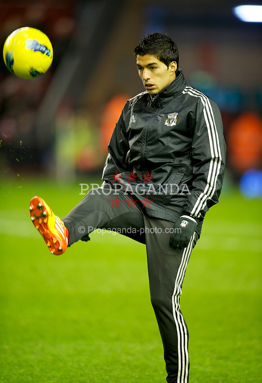 LIVERPOOL, ENGLAND - Monday, February 6, 2012: Liverpool's Luis Alberto Suarez Diaz warms-up before the Premiership match against Tottenham Hotspur at Anfield. (Pic by David Rawcliffe/Propaganda)