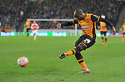 Hull City midfielder Sone Aluko (24) shoots at goal from close range  during the The FA Cup fifth round match between Hull City and Arsenal at the KC Stadium, Kingston upon Hull, England on 8 March 2016. Photo by Ian Lyall.