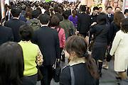 business commuters on there way home Shinjuku railway station Japan