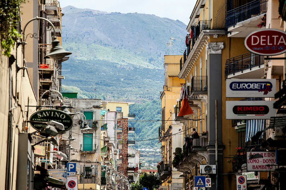 21 May 2017, San Giorgio a Cremano, Naples Italy - The city center of San Giorgio a Cremano with volcano Vesuvius. San Giorgio a Cremano is located in the red zone instituted by Italian Government for the national evacuation plan in case of eruption of the Vesuvio.