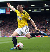 Jake Bidwell shooting from a tight angle during the Sky Bet Championship match between Fulham and Brentford at Craven Cottage, London, England on 3 April 2015. Photo by Matthew Redman.
