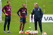 England manager Roy Hodgson talks to strikers Theo Walcott and Harry Kane during the England Training Session at St George's Park National Football Centre, Burton-Upon-Trent, United Kingdom on 7 October 2015. Photo by Aaron Lupton.